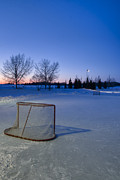 Pond Hockey Photos - Sunset with Vacant Pond Hockey Rink by Darcy Michaelchuk