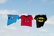 Washing Clothes Framed Prints - Superheroes Framed Print by Tim Gainey