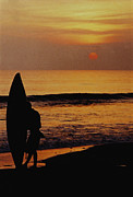 Silhouetted Metal Prints - Surfing at Sunset Metal Print by Anonymous