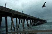 Ocean Photos Framed Prints - Surreal Stormy Blue Pier Beach Ocean Fishing Pier With Seagull Framed Print by Kathy Fornal