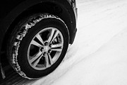 Suv Posters - suv all weather car tire in the snow Saskatoon Saskatchewan Canada Poster by Joe Fox