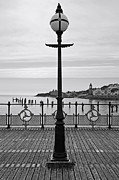 Stopper Framed Prints - Swanage Pier Lampost Framed Print by Richard Thomas