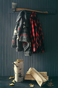 Sandra Cunningham - Sweater jacket hanging with firewood with axe