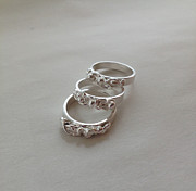 Metal Jewelry Prints - Swiggle Fine Silver Stackable Rings Print by Carrie  Godwin