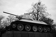 Berlin Germany Prints - T-34 tank on plinth at the soviet war memorial tiergarten Berlin Germany Print by Joe Fox