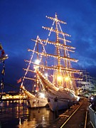 Lights Glass Art Prints - Tall ships at night time Print by Joe Cashin