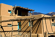 Taos Prints - Taos Pueblo Striking Shadows Print by Marilyn Hunt