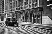 Dappled Light Framed Prints - Taxi on a deserted City street Framed Print by Lana Enderle