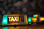 Illuminated Framed Prints - Taxi signs Framed Print by Carlos Caetano