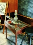 One Room Schoolhouse Prints - Teacher - Teachers Desk With Hurricane Lamp Print by Susan Savad
