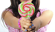 Adolescence Photos - Teen offers lollipop to viewer by Doron Magali