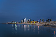 Relaxed Framed Prints - Tel Aviv the blue hour Framed Print by Ron Shoshani