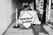 Temporary Framed Prints - temporary sidewalk closed signs at construction site in downtown Vancouver BC Canada Framed Print by Joe Fox