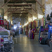 Souk Framed Prints - Textile bazaar Framed Print by Paul Cowan
