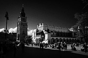 Polish City Prints - The 16th century Cloth Hall Sukiennice building and 13th century  Gothic town hall tower with tourists in rynek glowny town square krakow Print by Joe Fox