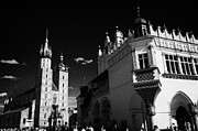 Town Square Prints - The 16th century Cloth Hall Sukiennice building and 14th century  Gothic Basilica of the Virgin Mary Print by Joe Fox