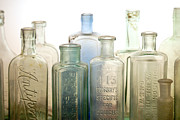 Medicine Bottle Posters - The Ages Reflected in Glass Poster by Holly Kempe