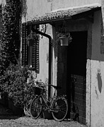 Civitavecchia Prints - The Bicycle under the Porch Print by Dany Lison