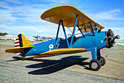 Historic Military Vehicle Posters - The Blue Machine - Stearman Biplane Poster by Leanne Howie