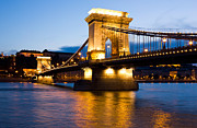 Famous Bridge Metal Prints - The Chain Bridge in Budapest lit by the street lights Metal Print by Kiril Stanchev