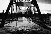 Old North Bridge Prints - the closed old traffic bridge over the south saskatchewan river in winter downtown Saskatoon Saskatc Print by Joe Fox