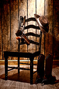 Holster Framed Prints - The Cowboy Chair Framed Print by Olivier Le Queinec