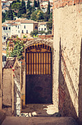 Picturesque Town Posters - The Door with Overview of Ronda Poster by Jenny Rainbow