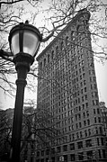Nyc Scenes Posters - The Flatiron Building in New York City Poster by Ilker Goksen