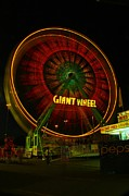 Carnivals Photos - The Giant Wheel Spinning  by Jeff  Swan