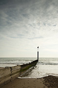 Grey Clouds Posters - The Groyne Poster by Anne Gilbert