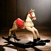 Reproduction Metal Prints - The Happy Little Rocking Horse in the Attic Metal Print by Olivier Le Queinec