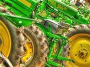 Old Tractors Photos - The John Deere Line by Michael Allen