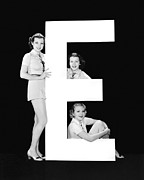 "Matching Outfits Framed Prints - The Letter ""E"" And Three Women Framed Print by Underwood Archives"