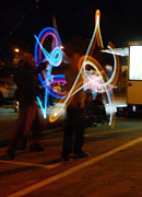 Juggling Photo Prints - The Light Jugglers Print by Steve Taylor
