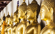 Statue Portrait Prints - The main hall of Wat Thardtong with golden Buddha statue Print by Anek Suwannaphoom