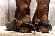 Cowboy Photos - The Muddy Boots by Olivier Le Queinec