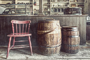 Barrels Framed Prints - The Old General Store - Red chair and Barrels in this 19th Century Store Framed Print by Gary Heller
