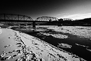 Old North Bridge Prints - The Old Traffic And Broadway Bridges Over The South Saskatchewan River In Winter Flowing Through Dow Print by Joe Fox