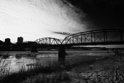 Old North Bridge Prints - the old traffic bridge over the south saskatchewan river in winter flowing through downtown Saskatoo Print by Joe Fox