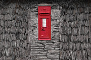 Antiquated Prints - The red letter box in a stone wall Print by Laurence Delderfield