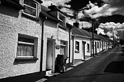 Small Village Framed Prints - The Row Seamount Row Of Traditional Pebble Dashed Small Fishing Cottages On A Hill In Courtown Harbour Framed Print by Joe Fox