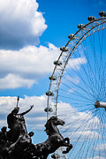Chariot Posters - The Statue of Boadicea standing in front of the London Eye in England Poster by Nila Newsom
