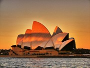 Sydney Photographs Posters - The sun sets on The Opera House Poster by Peter Evans