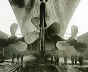 Docked Boats Photo Prints - The Titanics propellers in the Thompson Graving Dock of Harland and Wolff Print by English Photographer