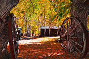 Old Cabins Prints - The Welcome Wagon Wheels Print by Lynn Bauer