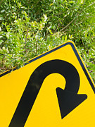 Directional Signage. Prints - Think green - U-turn roadsign in lush vegetation Print by Stephan Pietzko