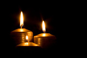 Candle Lit Prints - Three golden candles burning in the darkness Print by Jose Elias - Sofia Pereira