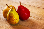 Ruby Acrylic Prints - Three Pears on a Rustic Wood Surface Acrylic Print by Colin and Linda McKie