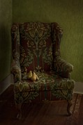 Wooden Chair Prints - Three Pears Sitting In A Wing Chair Print by Priska Wettstein