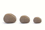 Neutral Colours Framed Prints - Three Pebbles against White Background Framed Print by Natalie Kinnear